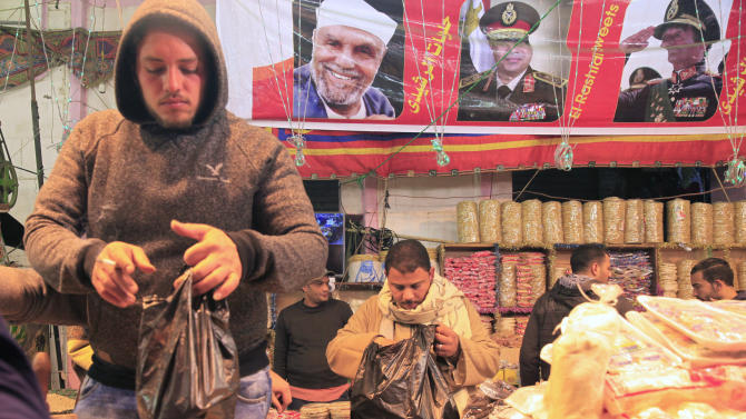 Street vendors sell nuts and traditional sweets as they celebrate Moulid Al-Hussein, the birthday of Prophet Mohammad's grandson Hussein in old Cairo