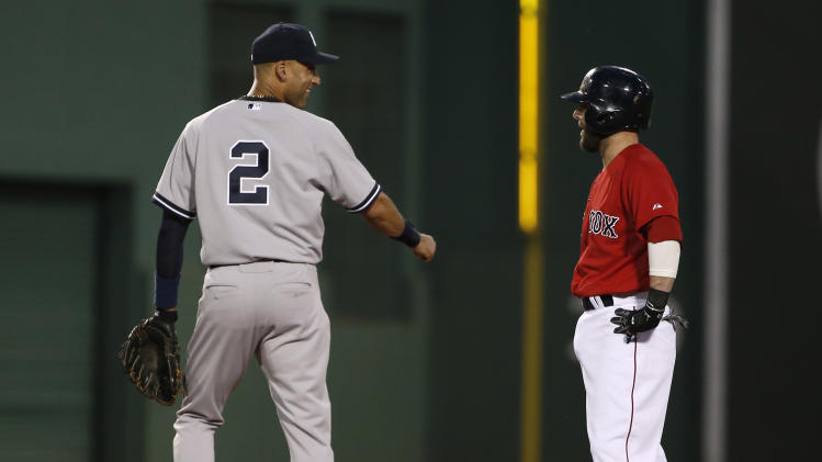 New York Yankees shortstop Derek Jeter laughs with Boston Red Sox's Dustin Pedroia after Pedroia's RBI double against the New York Yankees during the third inning of a baseball game at Fenway Park in Boston Friday, Aug. 1, 2014. (AP Photo/Winslow Townson)