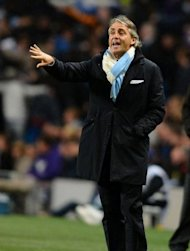 Manchester City&#39;s Italian manager Roberto Mancini reacts during the UEFA Champions League football match between Manchester City and Borussia Dortmund at the Etihad stadium, in Manchester. The match ended in a 1-1 draw