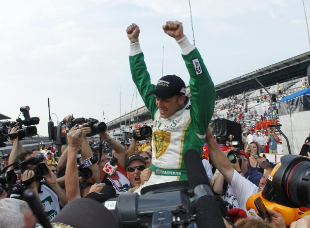 Carpenter of the U.S. celebrates taking pole position in the Indianapolis 500 at the Indianapolis Motor Speedway