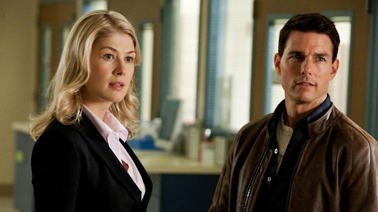"This undated publicity photo released by Paramount Pictures shows, from left, Rosamund Pike as Helen, and Tom Cruise as Reacher, in the film, ""Jack Reacher."" (AP Photo/Paramount Pictures, Karen Ballard)"