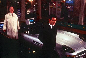 John Cleese as R, Q's assistant, and Pierce Brosnan as Bond in MGM's The World Is Not Enough