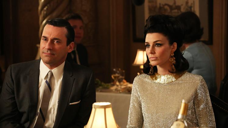 """This TV publicity image released by AMC shows Jon Hamm as Don Draper, left, and Jessica Pare as Megan Draper in a scene from """"Mad Men."""" The season finale airs Sunday, June 23, on AMC. (AP Photo/AMC, Michael Yarish)"""