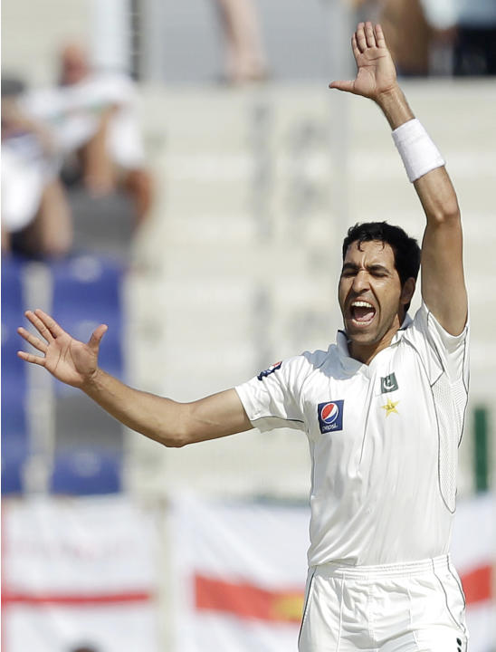 ALTERNATE CROP OF HAS109 - Pakistan's Umar Gul celebrates after taking the wicket of England's Ian Bell, not pictured, lbw during the third day of their second cricket test match of a three-ma