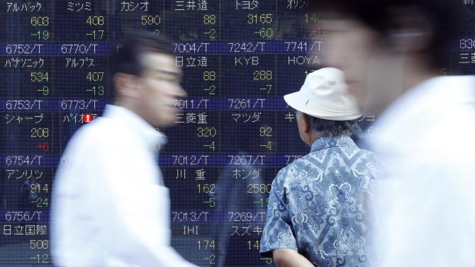 A man checks stock prices on the electronic stock board of a securities firm as others walk by in Tokyo Tuesday, Sept. 11, 2012.  Asian stock markets retreated Tuesday as investors sought safety ahead of critical events this week that will test Europe's willingness to unite in order to deal with a major debt crisis. (AP Photo/Koji Sasahara)