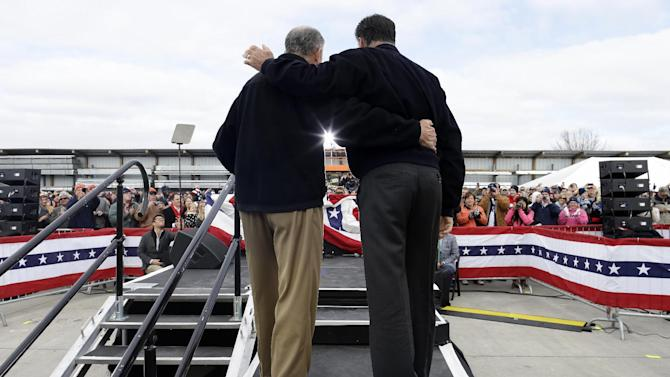 Republican presidential candidate, former Massachusetts Gov. Mitt Romney is introduced by Sen. Chuck Grassley, R-Iowa, before he speaking about the economy at a campaign rally at Kinzler Construction Services in Ames, Iowa, Friday, Oct. 26, 2012. (AP Photo/Charles Dharapak)