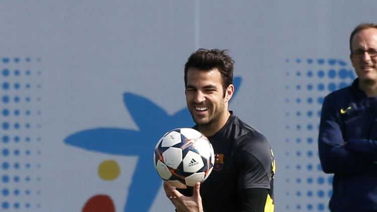 Barcelona's Cesc Fabregas smiles during the training session at Ciutat Esportiva Joan Gamper in Sant Joan Despi ahead of the Champions League last 16 second leg against Manchester City
