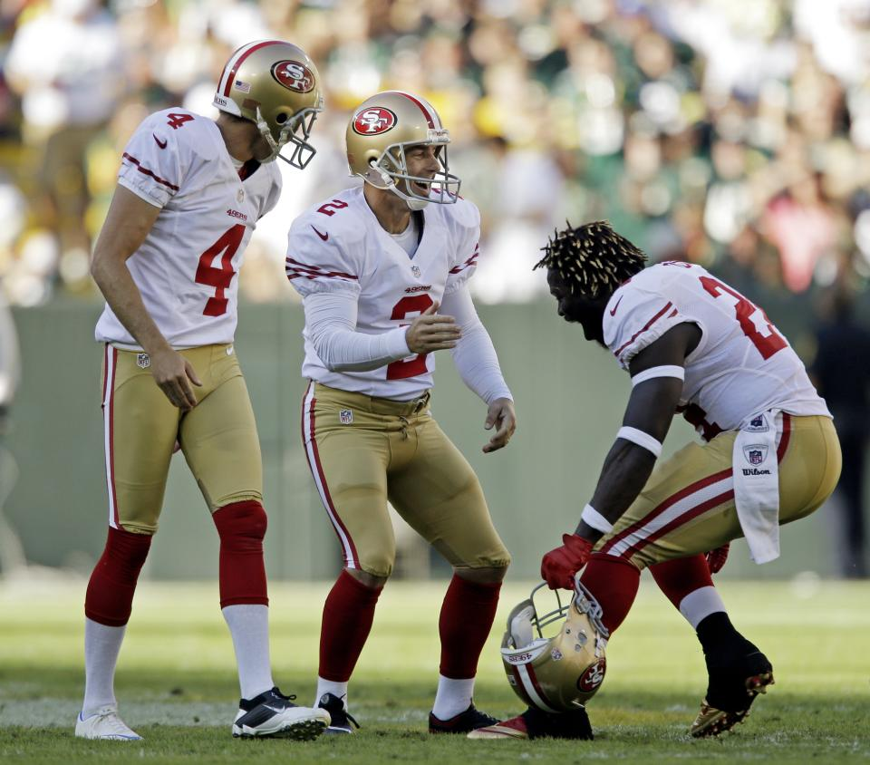San Francisco 49ers kicker David Akers celebrates after kicking a 63-yard field goal during the first half of an NFL football game against the Green Bay Packers Sunday, Sept. 9, 2012, in Green Bay, Wis. (AP Photo/Jeffrey Phelps)