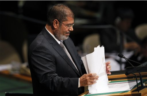 Egypt's President Mohamed Mursi collects his speech after addressing the 67th United Nations General Assembly at the U.N. Headquarters in New York