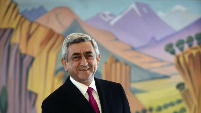 Armenian President Serge Sarkisian smiles as he casts his ballot during presidential election in Yerevan, Armenia Monday, Feb. 18, 2013. Armenian President Serge Sarkisian was re-elected for a second term in the first round of the ex-Soviet nation's presidential election, according to an exit poll Monday.The poll of 19,130 voters conducted by Gallup International and carried by ArmNews TV showed Sarkisian winning 58 percent of Monday's ballot.  (AP Photo/PanARMENIAN  Tigran Mehrabyan)