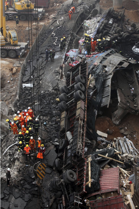 Rescuers work at the accident site where an expressway bridge partially collapsed due to a truck explosion in Mianchi County, Sanmenxia, central China's Henan Province, Thursday, Feb. 1, 2013. A t