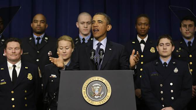 FILE - In this Tuesday, Feb. 19, 2013 file photo, President Barack Obama speaks at the White House in Washington about potential automatic budget cuts, accompanied by emergency responders, a group of workers he says could be affected if state and local governments lose federal money as a result of the cuts. As economic policy goes, experts say, the automatic spending cuts that kick in Friday, March 1, are a bad idea. (AP Photo/Charles Dharapak, File)