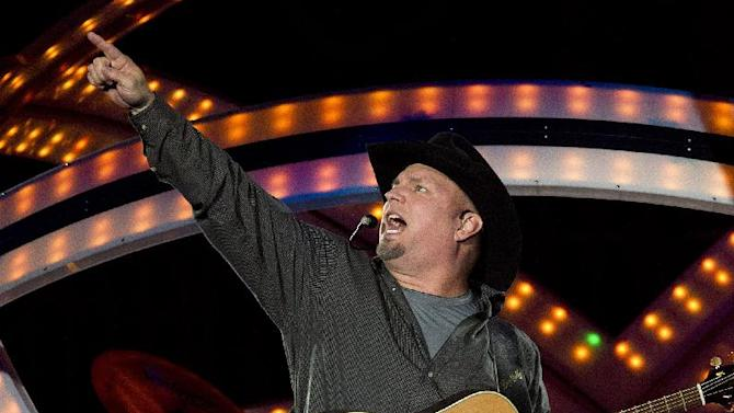 Country superstar Garth Brooks performed on the opening night of seven dates at Philips Arena on Friday, September 19, 2014, in Atlanta, Ga. (Photo by Dan Harr/Invision/AP)