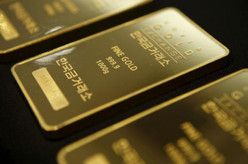 Gold slips on dollar after ECB comments, eyes on U.S. data