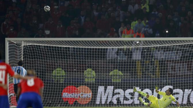 Argentina's Gonzalo Higuain misses high during a penalty kick shootout at the Copa America 2015 final soccer match against Chile at the National Stadium in Santiago
