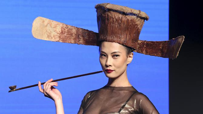 """A model presents a creation made with chocolate by designer Wang and Maitre Chocolatier Rinaldini during the international exhibition of chocolate """"Salon du Chocolat"""" in Milan, Italy"""