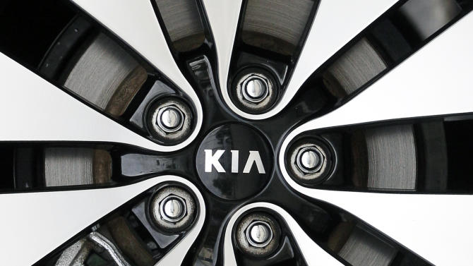 In this Oct. 5, 2012, photo, a KIA logo is seen on a wheel rim at a dealership in Chicago. Major automakers are reporting Thursday, Nov. 1, 2012, that sales increased for October despite losing three days of business to the punishing rain and wind from superstorm Sandy.  (AP Photo/Nam Y. Huh)
