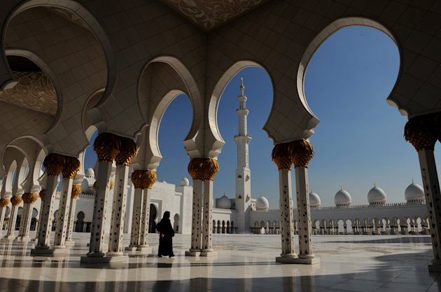 ABU DHABI, UNITED ARAB EMIRATES - DECEMBER 17:  A woman strolls the Sheikh Zayed Mosque on December 19, 2009 in Abu Dhabi, United Arab Emirates. The Mosque, named after Sheikh Zayed bin Sultan Al Nahyan, is the biggest mosque in the United Arab Emirates.  (Photo by Jasper Juinen/Getty Images)
