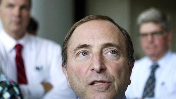Commissioner Gary Bettman speaks to journalists after leaving hockey labor negotiations between the NHL and the NHL Players' Association, Monday, Aug. 13, 2012, in Toronto. (AP Photo/The Canadian Press, Chris Young)