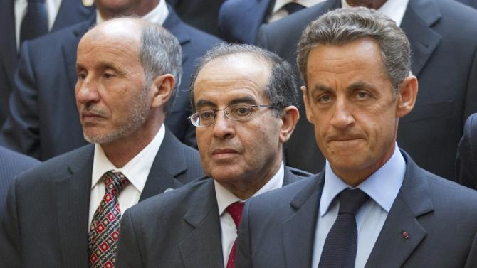 Libyan Transitional National Council chairman Mustafa Abdel Jalil, left, and Libyan Transitional National Council Prime Minister Mahmoud Jibril, center, stand with French President Nicolas Sarkozy as they pose for photographs at the Elysee Palace in Paris, Thursday, Sept. 1, 2011.  (AP Photo/Evan Vucci, Pool)
