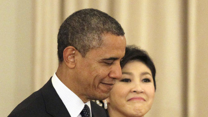 U.S. President Barack Obama, left, and Thai Prime Minister Yingluck Shinawatra arrive for a joint press conference at the Government House in Bangkok, Thailand, Sunday, Nov. 18, 2012. (AP Photo/Sakchai Lalit)