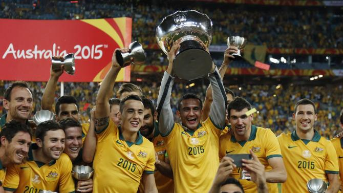 Australia's Luongo takes a 'selfie' with team mates as they celebrate with their medals and the Asian Cup trophy after beating South Korea to win the tournament in Sydney