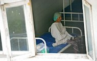 A patient waits for an operation at a public hospital in Yangon. Medecins Sans Frontieres says only a third of the 120,000 people living with HIV in Myanmar, who under World Health Organization standards should receive antiretrovirals, are being treated