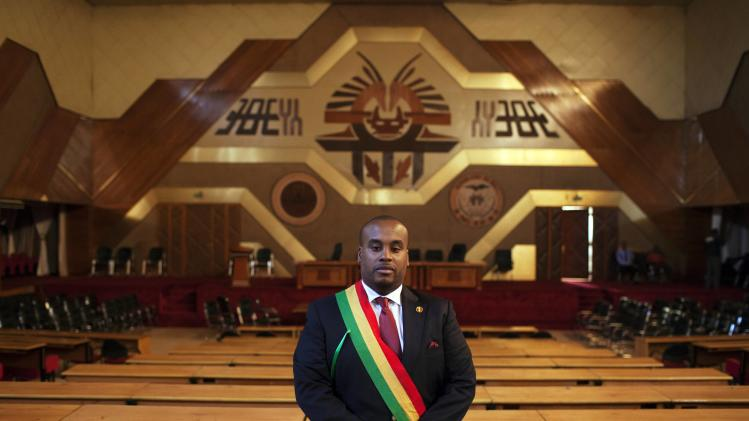 Karim Keita, member of parliament and the son of Malian President Keita, poses for a picture in the parliament's main hall in Bamako