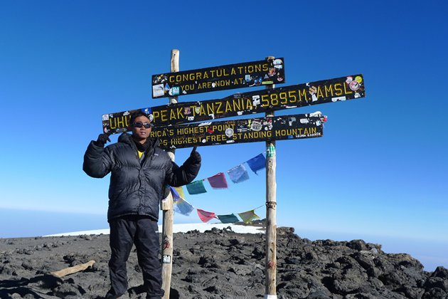 Salihin bin Sinai stands atop the summit of Mount Kilimanjaro after he successfully scaled it in June 2011. (Photo courtesy of Special Olympics Singapore)