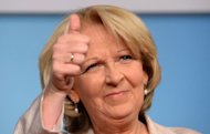 Hannelore Kraft, Germany&#39;s top candidate of the Social Democratic Party (SPD) celebrates after the publication of first results of the regional elections of North Rhine-Westphalia in Berlin. Voters in a crucial German state emphatically punished Chancellor Angela Merkel&#39;s pro-austerity party Sunday, awarding her main centre-left rivals a major boost ahead of 2013 national elections