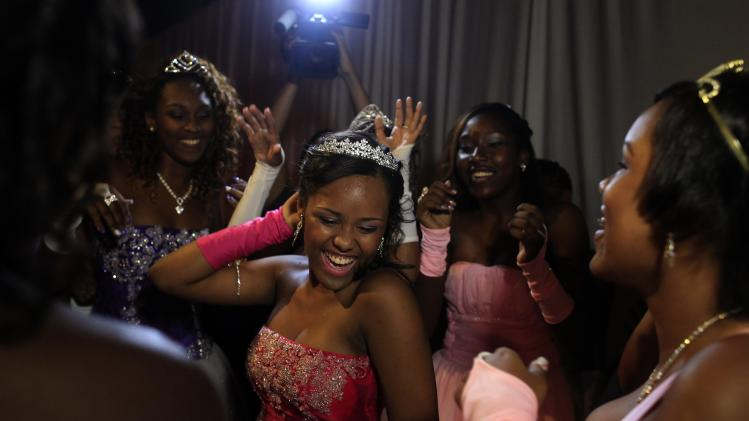 A fifteen-year-old girl dances as she is surrounded by friends during their debutante ball in Rio de Janeiro