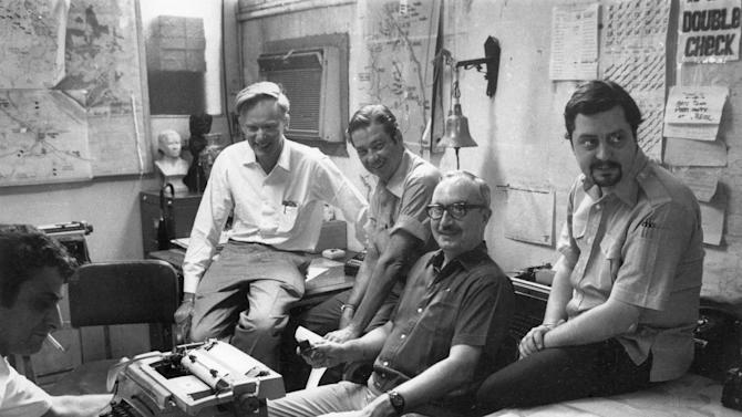 This April 28, 1972 file photo shows once-and-future bureau chiefs at The Associated Press' Saigon bureau, from left, George Esper (1973-75), Malcolm Browne (1961-64), George McArthur (1968-69), Edwin Q. White (1965-67), and Richard Pyle (1970-73). McArthur, a former AP foreign correspondent who reported all over the world and spent years in Saigon covering the Vietnam war, has died. He was 88. His wife, Eva Kim McArthur said he died Friday night, April 12, 2013 in a hospice in Fairfax County, Va., of complications from a stroke. (AP Photo)