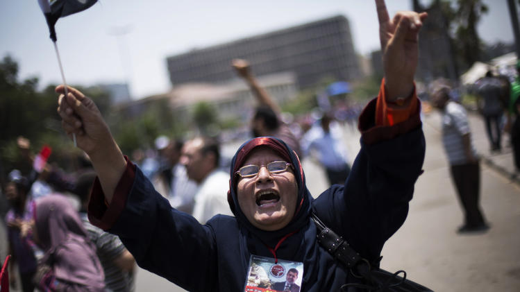 "An Egyptian woman chants slogans supporting Egypt's Islamist President Mohammed Morsi during a rally near Cairo University in Giza, Egypt, Tuesday, July 2, 2013. Egypt was on edge Tuesday following a ""last-chance"" ultimatum the military issued to Mohammed Morsi, giving the president and the opposition 48 hours to resolve the crisis in the country or have the army step in with its own plan.(AP Photo/ Manu Brabo)"