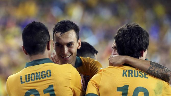 Australia's Massimo Luongo celebrates with teammates Trent Sainsbury, Tim Cahill and Robbie Kruse after scoring a goal against South Korea during their Asian Cup final soccer match at the Stadium Australia in Sydney