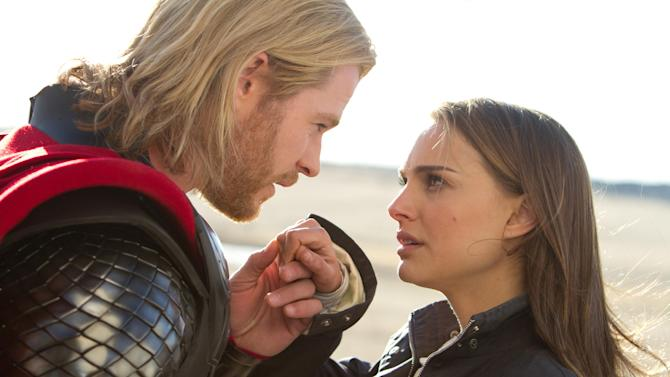 """In this film publicity image released by Paramount Pictures, Chris Hemsworth, portraying superhero Thor, and Natalie Portman, portraying jane Foster, are shown in a scene from the film, """"Thor."""" Hitting Chris Hemsworth was """"one small slap for womankind"""" says Natalie Portman. The actress, who reprises her role as Jane Foster in """"Thor: The Dark World,"""" gives the superhero a swipe round the face when she reunites with him for the Marvel sequel. (AP Photo/Paramount Pictures-Marvel Studios, Zade Rosenthal)"""