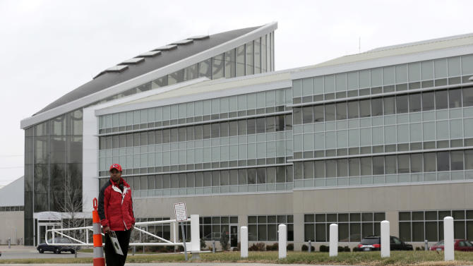 A security guard stands outside the training facility for the Kansas City Chiefs NFL football team on Saturday, Dec. 1, 2012, in Kansas City, Mo. A 25-year-old Chiefs player fatally shot his girlfriend early Saturday, then drove to Arrowhead Stadium and committed suicide in front of two team officials, police said. (AP Photo/Charlie Riedel)