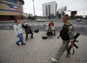 Street musicians perform in the town of Donetsk, eastern …