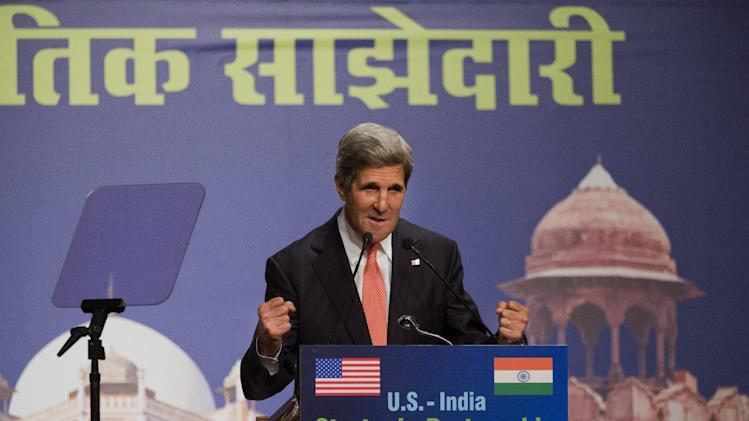 U.S. Secretary of State John Kerry gestures while making a speech that was in part about climate change at the India Habitat Center in New Delhi, India on Sunday, June 23, 2013, on his first visit to India as secretary. (AP Photo/Jacquelyn Martin, Pool)