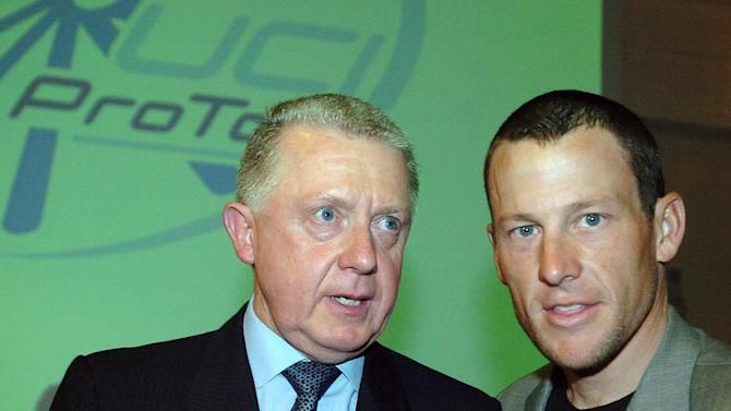 FILE - This March 5, 2005, file photo shows  Hein Verbruggen, left, president of the International Cycling Union, and cyclist Lance Armstrong, at the launch of the Cycling Pro Tour, in Paris.  Verbruggen has denied allegations that the governing body covered up a suspicious drug test result by Armstrong at the 2001 Tour de Suisse. (AP Photo/Christophe Ena, File)