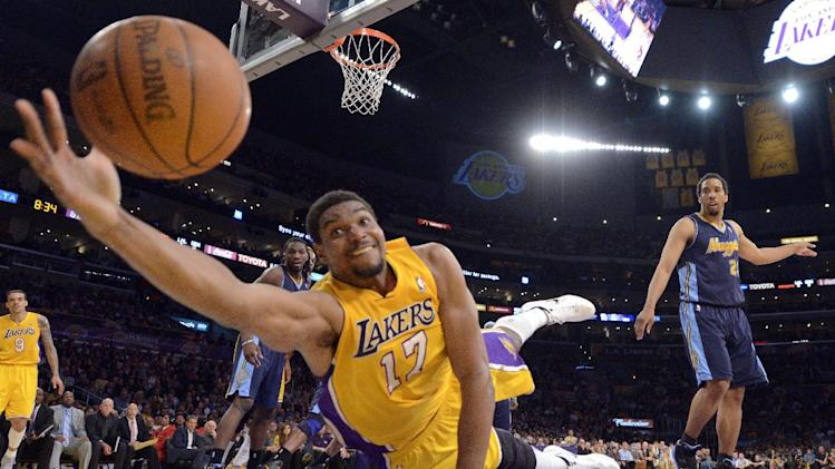 Los Angeles Lakers center Andrew Bynum dives to for a loose ball as Denver Nuggets guard Andre Miller, right, looks on during the first half in Game 5 of an NBA first-round playoff basketball game, Tuesday, May 8, 2012, in Los Angeles. (AP Photo/Mark J. Terrill)