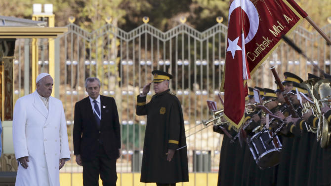Pope Francis is welcomed at the Presidential palace in Ankara, Friday, Nov. 28, 2014. Pope Francis arrived in Turkey on Friday at a sensitive moment for the Muslim nation, as it cares for 1.6 million refugees and weighs how to deal with the Islamic State group as its fighters grab chunks of Syria and Iraq across Turkey's southern border. (AP Photo/Burhan Ozbilici)