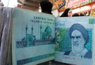 <p>File photo of Iranian rial banknotes bearing a portrait of the late founder of the Islamic Republic of Iran, Ayatollah Ruhollah Khomeini. Beijing reacted furiously Wednesday to new US sanctions imposed on a Chinese bank over transactions with Iran, urging Washington to revoke them and saying it would lodge an official protest.</p>