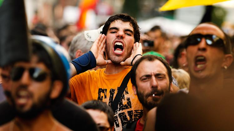 Protesters demonstrate against the country's near 25 percent unemployment rate and stinging austerity measures introduced by the government, in Madrid, Spain, Saturday, July 21, 2012. (AP Photo/Andres Kudacki)