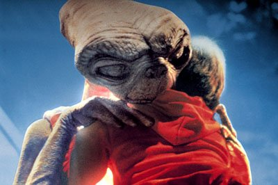 E.T. hugs Elliott ( Henry Thomas ) in Universal's E.T. The Extra-Terrestrial
