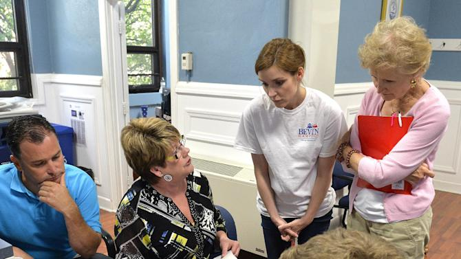 Ohio County Clerk Bess Ralph, center left, discusses the vote totals with Matt Bevin representatives Peggy Ranney, right, and Sarah Durand during the recanvass of the Kentucky Republican Gubernatorial primary, Thursday May 28, 2015, in Hartford Ky. Left is Ohio County Board of Elections member Marty Shephard. (AP Photo/Timothy D. Easley)