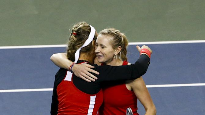 Victoria Azarenka and Olga Govortsova of Belarus celebrate after defeating Shuko Aoyama and Ayumi Morita of Japan during their Fed Cup World Group II play-off double tennis match in Tokyo