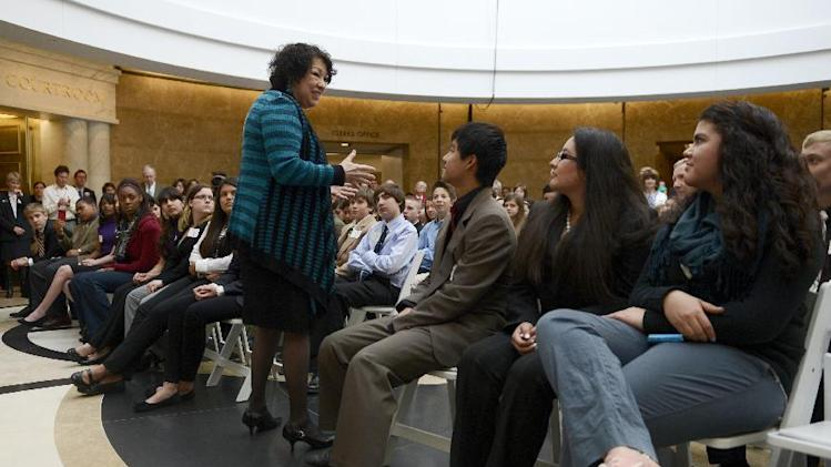 Supreme Court Justice Sonia Sotomayor  visits with students during a celebration to dedicate the new Ralph Carr Colorado Judicial Center, the home of the state Supreme Court and Court of Appeals in Denver,  Thursday, May 2, 2013. (AP Photo/The Denver Post,  RJ Sangosti, Pool)