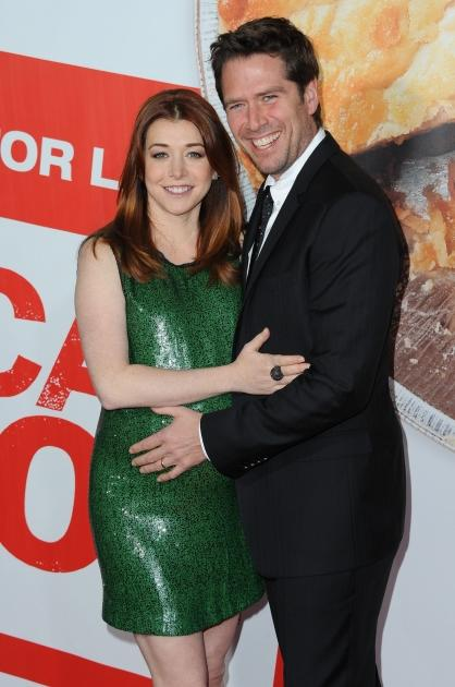 Alyson Hannigan and Alexis Denisof arrive at the 'American Reunion' Los Angeles Premiere at Grauman's Chinese Theatre, Los Angeles, on March 23, 2012 -- Getty Premium