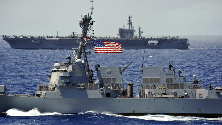 USS Chung-Hoon guided-missile destroyer, front, and the USS Nimitz aircraft carrier