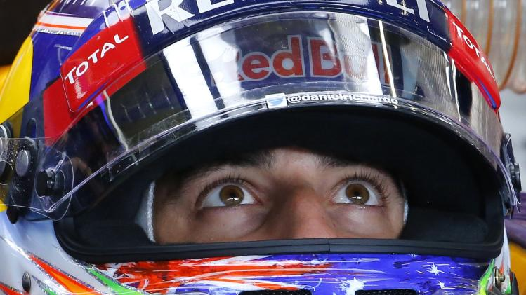 Red Bull Racing Formula One driver Ricciardo looks at the control screen during a practice session at the Belgian F1 Grand Prix in Spa-Francorchamps